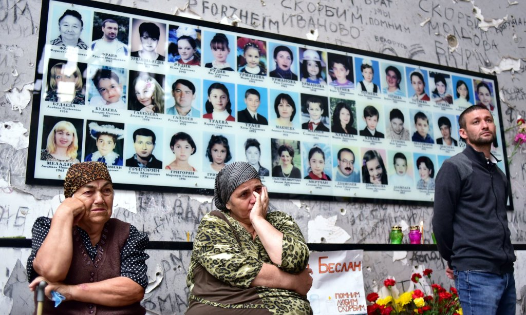 People gather in the gym at School Number One to commemorate the victims of the Beslan school siege that killed 334. Photograph: Anton Podgaiko/Tass