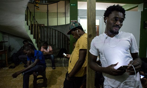 Migrants gather in a hotel known as Mama Africa in downtown Tapachula, which is almost exclusively African. Photograph: Encarni Pindado for the Guardian