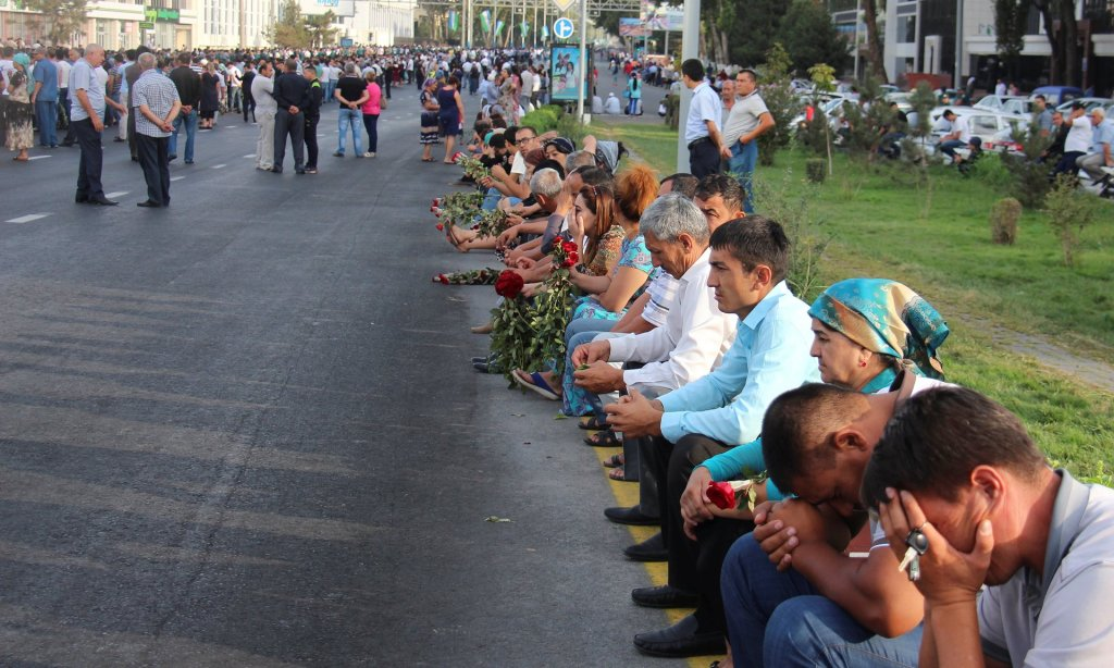 People gather to pay the tribute to Islam Karimov in Tashkent. Photograph: STRINGER/Reuters