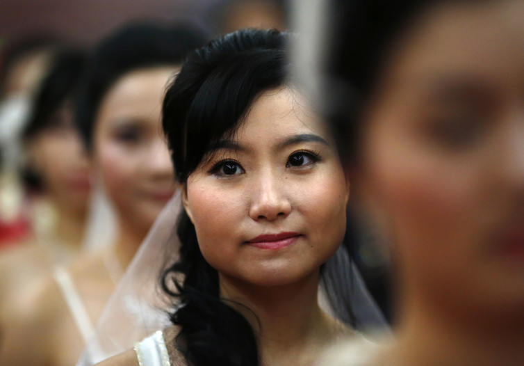 Chinese women receive no effective protection from the law in case their marriage dissolves. Carlos Barria/Reuters