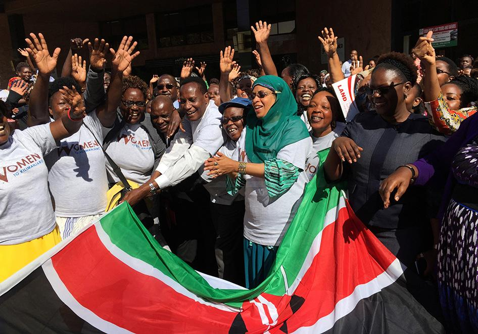 Kenya's Lands Minister and principal secretary in the Lands and Physical Planning Ministry welcome a group of women on October 13, 2016 who will climb Mount Kilimanjaro on October 14 as part of a campaign for land rights in Nairobi, Kenya. © 2016 Reuters