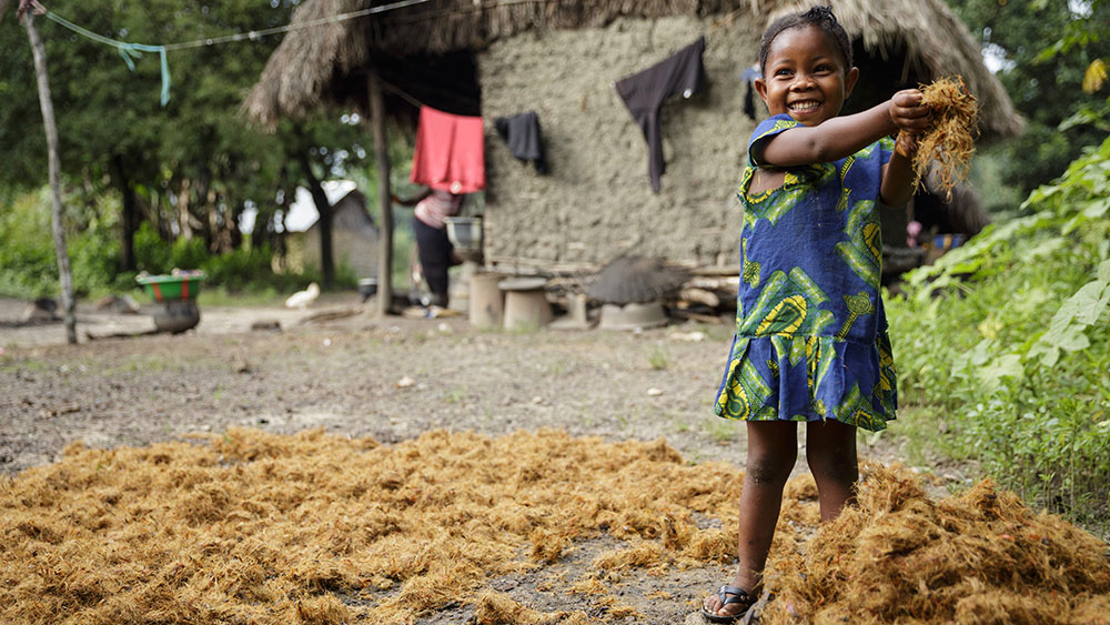 Girls as young as five spend hours each week working around the home. (UNICEF/Asselin)