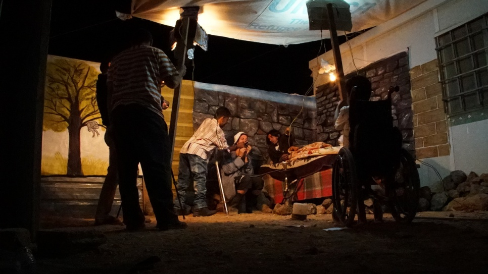 Filming often takes place at night due to the lack of electricity in the camp during the day, when the group hold rehearsals instead. © UNHCR/Houssam Hariri
