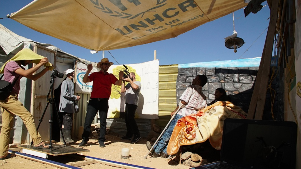 The group have constructed many materials from scratch, including hand-painted backdrops and stage lights made from discarded olive oil cans and aluminium foil. © UNHCR/Houssam Hariri