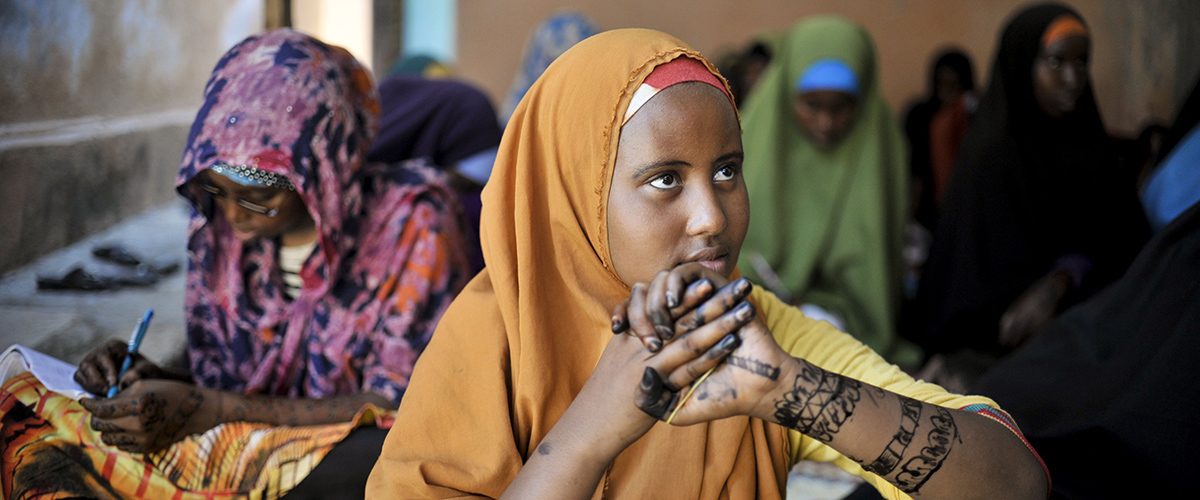 A girl at the Mother and Child Health Center in Mogadishu, Somalia, sits with other girls during a visit by the Special Representative of the Secretary-General on Sexual Violence in Conflict to the hospital on April 2. The SRSG, Zainab Bangura, visited Somalia this week on a mission to engage with various stakeholders on ways in which conflict related sexual violence can be addressed and prevented. The SRSG visited various IDP camps, hospitals, and women's shelters while in the country. AU UN IST PHOTO / TOBIN JONES.
