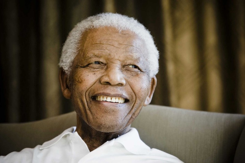 Nelson Mandela smiles in Johannesburg, South Africa on June 2, 2009, during a meeting with a group of American and South African students as part of a series of activities leading to Mandela Day on July 18th.