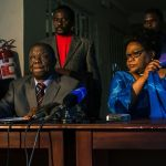 Morgan Tsvangirai and Joice Mujuru sign a Memorandum of Understanding to negotiate a coalition ahead of the 2018 general election in Harare on April 19 2017. Photographer: Jekesai Njikizana/AFP/Getty Images