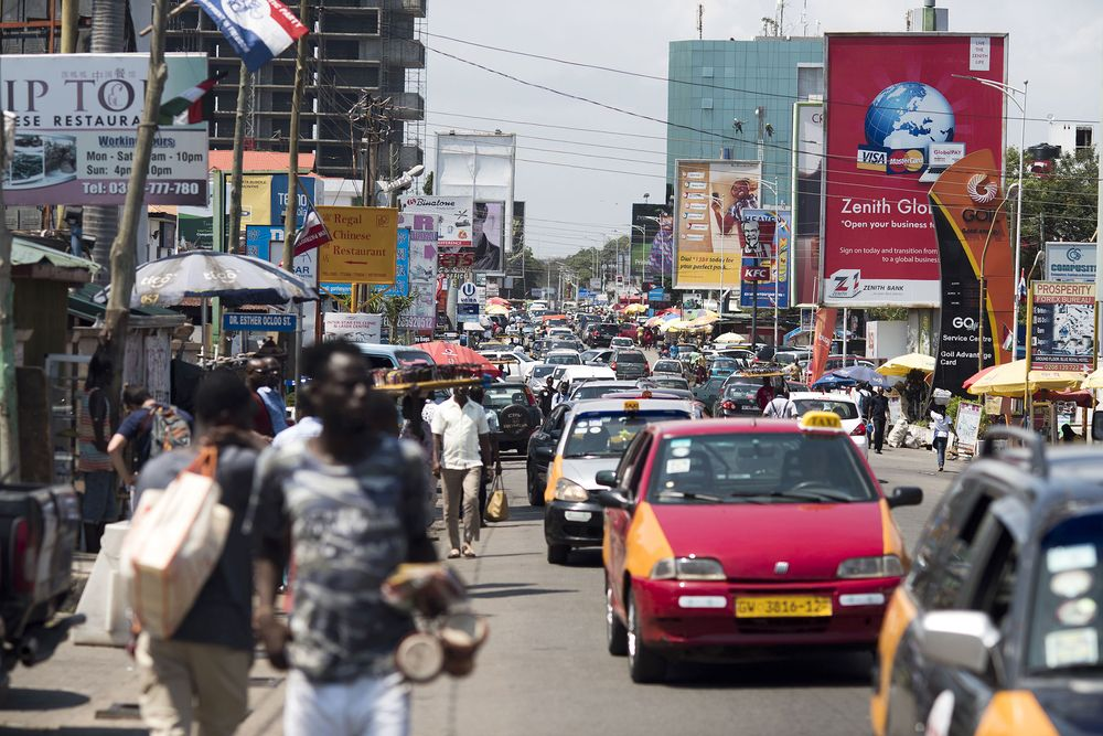 Road traffic passes business advertisements for Zenith Bank Plc and MTN Group Ltd. sit on a busy highway in Accra, Ghana. Photographer: Ty Wright/Bloomberg via Getty Images