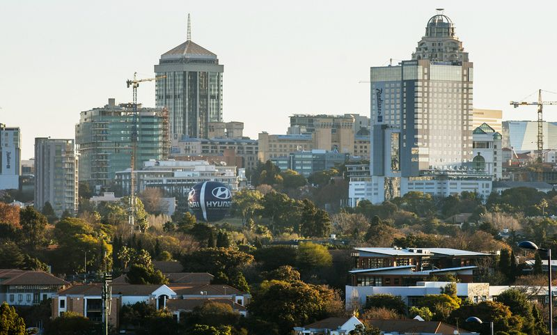 Buildings stand in the Central Business District on the city skyline of Johannesburg, South Africa. Photographer: Waldo Swiegers/Bloomberg