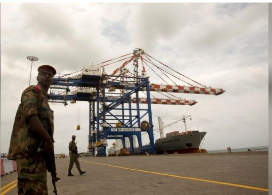 A Djibouti policeman stands guard during the opening ceremony of Dubai-based port operator DP World's Doraleh container terminal in Djibouti port February 7, 2009. REUTERS/Ahmed Jadallah/File Photo