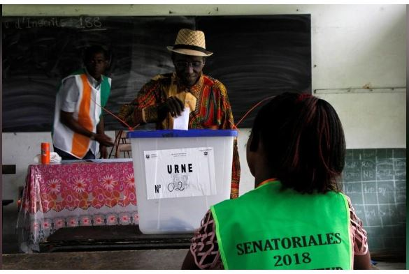 A man casts his ballot during Ivory Coast's first ever election of senate members in Abidjan, Ivory Coast March 24, 2018. REUTERS/Luc Gnago
