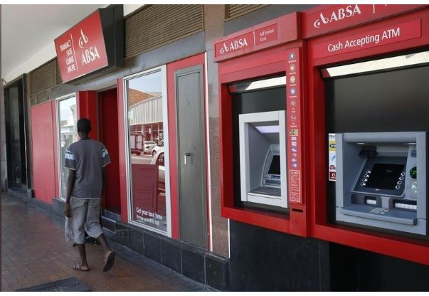A man walks past a branch of South Africa's retail bank, Absa, in Cape Town, file. EUTERS/Mike Hutchings