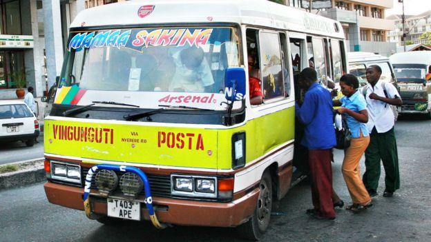 "It is often a scramble to get a seat in on a ""dala dala"" in Dar es Salaam . Photo: Alamy"