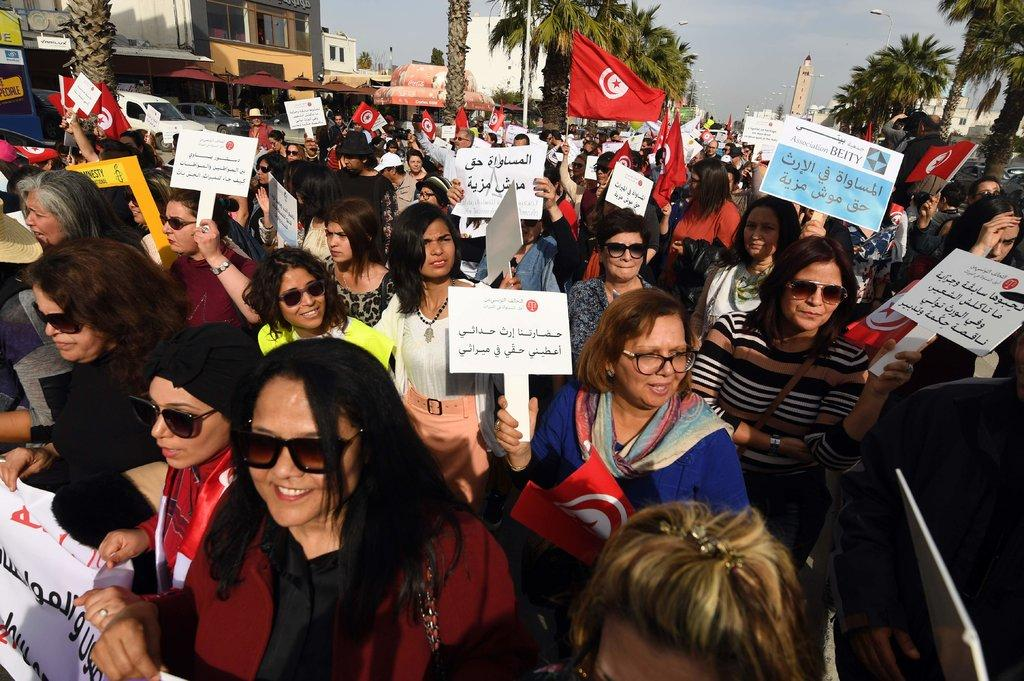 Demonstrating for women's rights under religious law last month in Tunis, the capital of Tunisia.CreditFethi Belaid/Agence France-Presse — Getty Images