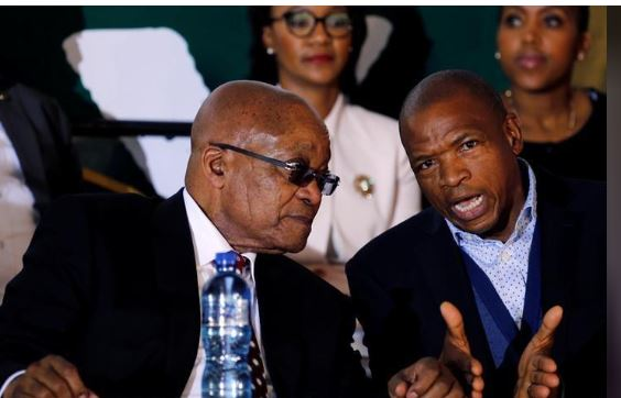 "South Africa's former president Jacob Zuma chats with Premier of North West Province Supra Mahumapelo before addressing the National Youth Day commemoration, under the theme ""The Year of OR Tambo: Advancing Youth Economic Empowerment"", in Ventersdorp, South Africa June 16, 2017. REUTERS/Siphiwe Sibeko"