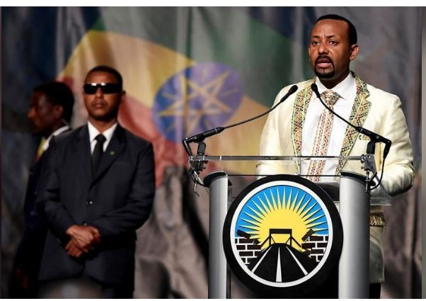 "Ethiopia's Prime Minister Abiy Ahmed addresses his country's diaspora, the largest outside Ethiopia, calling on them to return, invest and support their native land with the theme ""Break The Wall Build The Bridge"", in Washington, U.S., July 28, 2018. REUTERS/Mike Theiler/File Photo"