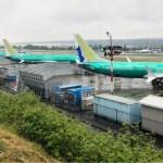 A row of three green 737 MAX jetliners sit parked on the tarmac at Renton Municipal Airport in Renton, Washington, U.S. May 16, 2019. REUTERS/Eric Johnson