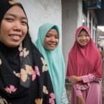 5 March, 2018, Kediri Village, Lombok  Indonesia: Local girls from left, Holida,18, Suci,18 and Ria,16, walking the streets of the K.R Bedil Utara village after talking with Girls Not Brides Mabel van Orange about child marriage and sexual health issues. The girls were inspired to join the local child protection units to spread the message about the dangers of child marriage often walking the streets of the villages with a megaphone and placards. Picture by Graham Crouch/Girls Not Brides