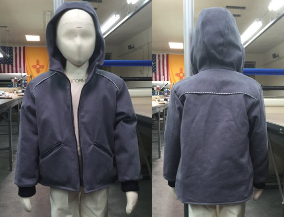 Front and back view of the coat produced at the apparel manufacturing boot camp in Albuquerque's sewing factory.