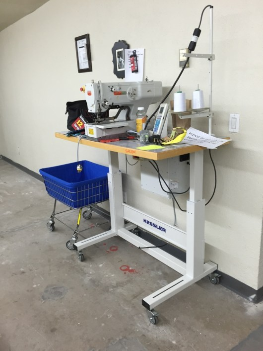 The button hole machine, Kessler automated table stand.