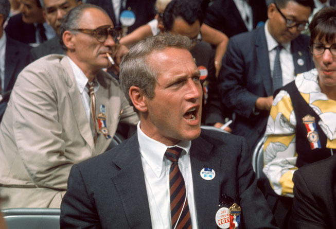 Newman voices off at the Democratic National Convention in Chicago, August 1968. Sitting behind him is playwright Arthur Miller, cigarette in mouth. By Lee Balterman/Time Life Pictures/Getty Images.