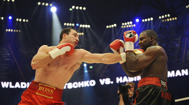 Klitschko lands shot to the head  of  Rahman .........