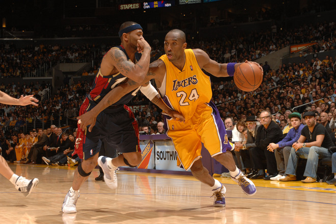 Bryant drives the lane against the Cavaliers' Mo  Williams .............