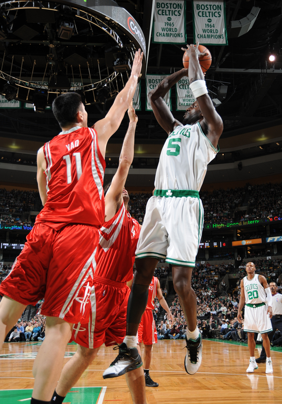 Garnett of the Celtics  attempts  a jump shot over the outstretched arms of the Rockets' Yao Ming  .............