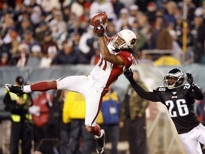 Larry Fitzgerald makes  a leaping  catch during  the  game against the Carolina  Panthers  .................