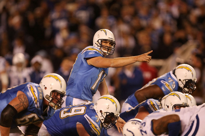 Phillip Rivers  of the Chargers  signals  a play  prior to the  snap against the  Colts ................