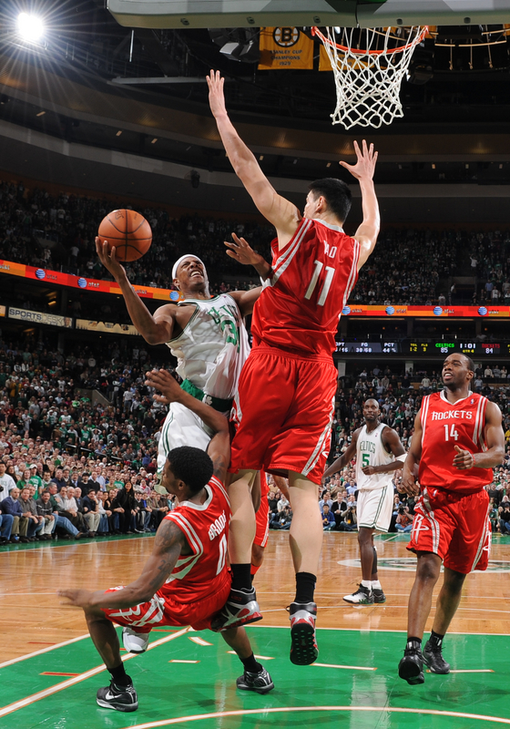 Yao Ming defends the paint as the Celtics' Paul Pierce drives to the basket  ...............