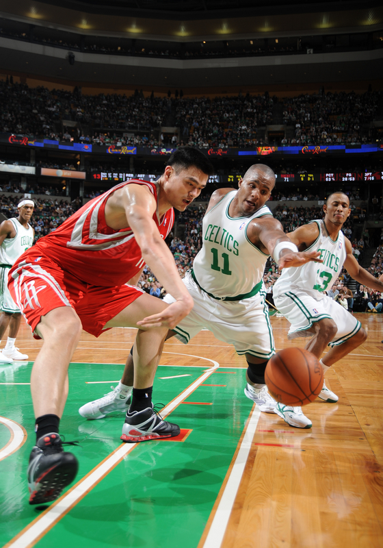 Yao Ming of the  Rockets  and  the  Celtics'  Glen  Davis pursue a loose ball......... .