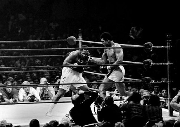 Ali  lands  a  blow to  the  head  of  Frazier  during  the  eighth  round  of  their  none   title  bout  at  Madison  Square  Garden  in  January  1974.