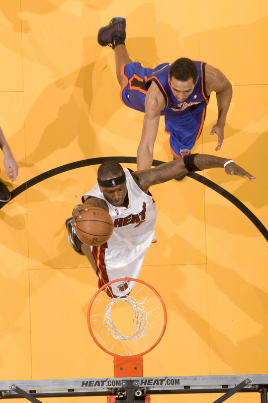 Jermaine  O'Neal  of  the  Miami  Heat   dunks  the  ball  against   New York  as  Jared Jeffries  of  the  Knicks  looks  on.  picture appears  courtesy of  nbae /getty images/ Victor Baldizon  .............