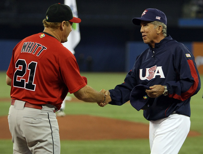 Managers  Ernie  Whitt  of  Canada  and  Davey Johnson of the  US  team   greet  each other  before the   game  between  their   two  teams .  picture appears courtesy of  getty images / Elsa  Martinez ..............