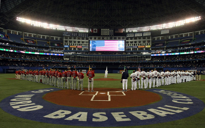 Members  of  the  US and  Canadian  teams  line  up  for  the  national  anthem  before  their   game  at  the  Rogers Center , Toronto.   picture appears  appears  courtesy of  getty  images/ Elsa Martinez  .........