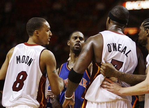 Jermaine  O'Neal  of  the  Miami Heat  has to be  restrained  by   teammate  Udonis  Haslem  having  got  into  an  altercation  with  Larry  Hughes  of the  New York  Knicks   during the  game.    picture  appears   courtesy  of  ap/photo/Lyne  Sladky ............
