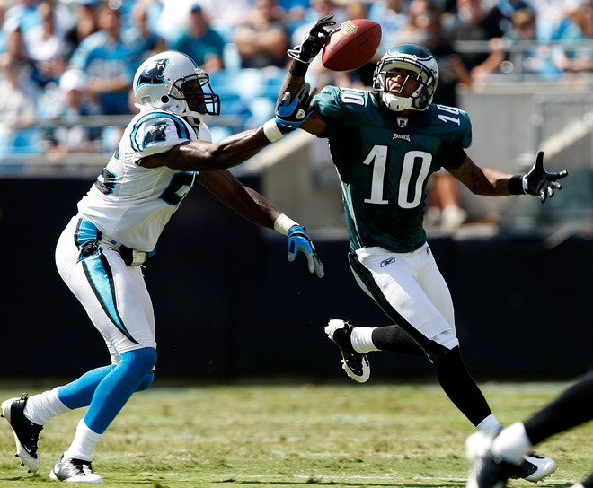 Eagles'  wide  receiver  DeSean  Jackson  (10)attempts  to  keep the  ball  in  play  as  it   bobbles  in the  air.     Jackson  and  the  Eagles   would   go  on  to  defeat  the  Carolina   Panthers   38-10  in  a  totally  lopsided   victory.  The  game  was  played   at the  Bank  of  America  Stadium   in  Charotte  , North  Carolina .         picture  appears  courtesy  of   getty  images  / Streeter  Lecka  ..............................