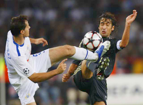 FC  Zurich's  Xavier  Margairaz   and  Real  Madrid's Raul  contest  a   loose  ball   during  the   Champions League  Group  C meeting.    Real  Madrid  would   go  on  to defeat  their   opponent   5-2 .    picture  appears  courtesy  of   ap/keystone/ photo/  Steffen  Schmidt  ......................