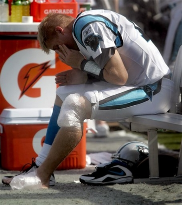 Panthers'  backup  quarterback  Josh  McCown  sits  on the  bench  having   sustained  a  leg  injury  in  the  second  half  of  the  game   against the  Philadelphia  Eagles.   The  Panthers  were   resoundingly   defeated   38-10   by  the  Eagles   in  a  game   played  in  Charlotte,  North  Carolina  .    picture  appears  courtesy  of   ap/photo/  Nell  Redmond  ......................