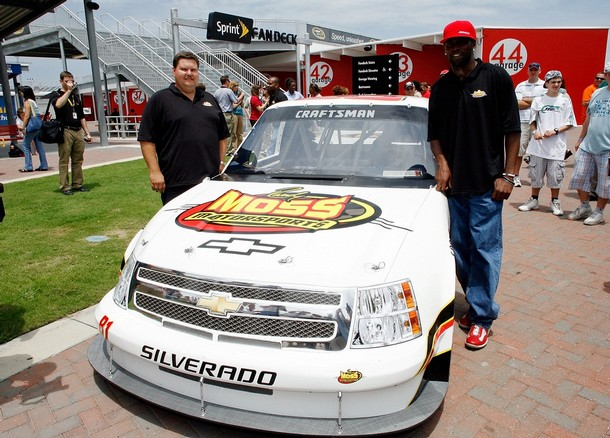 NFL  star , Randy Moss (right)  and  business  partner , David  Dollar  of   Randy Moss  Motorsports Inc   pose  alongside  the #81  Moss  Motorsports   Chevrolet  during  the  announcement    of   his  vehicle's  entry  in  the  Craftsman  Truck  Series  .   The  venue  was  at   Daytona  International  Speedway  ,  Daytona  Beach , Florida,.  picture  appears  courtesy  of  getty images/  Geoff Burke ...................