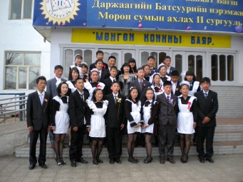 9th Grade Graduates. Formal uniforms for girls resemble French Maid's uniforms, while boys wear suits. On a regular school day in winter girls will wear several layers of pants under their dresses. Boys will likewise wear several layers of clothing under their uniforms.
