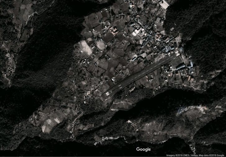 Satellite imagery of the Luka Airport airstrip details the treacherous terrain in which the Lukla airstrip leads into a brick wall on approach, ends at a cliff on departure, residential area or drop offs flank the airstrips on both sides, limiting pilots' options for emergency actions on takeoff and landing