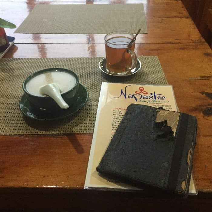Garlic soup, ginger tea, and notes for the following day of the trek. A common dinner table site on the road to EBC