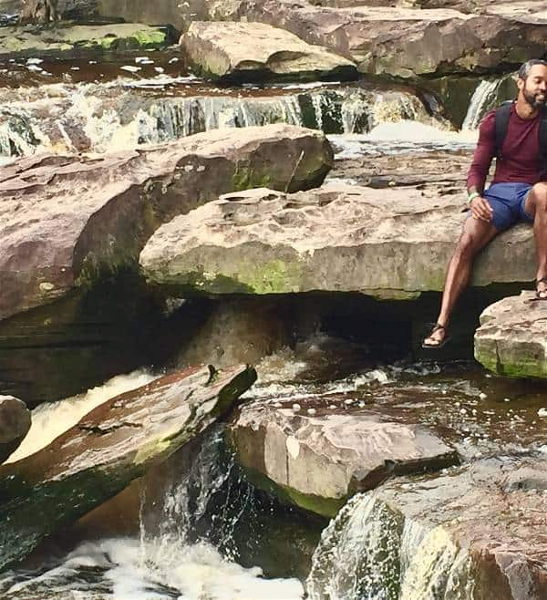 Enjoying a waterfall after hiking with the Xero Z-Trail sandals