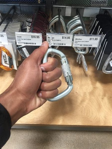 The carabiner needed to create a handle for the resistance band can be purchased at any REI or outdoor sports store, or rock climbing gear distributor