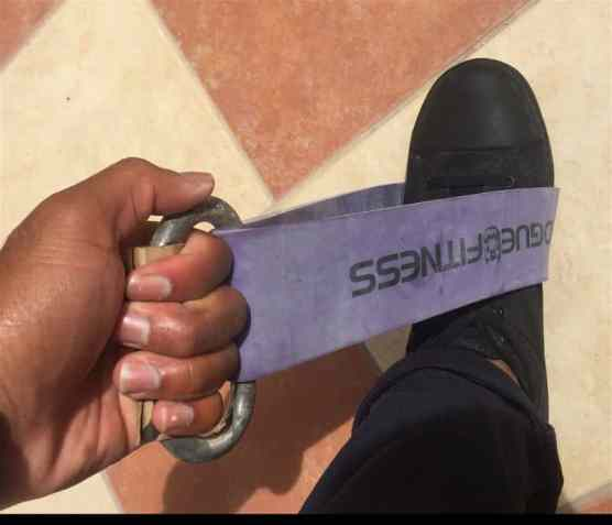 """The Rogue Fitness Monster """"Shorty Bands"""" with a carabiner allow us to recreate a deadlift with up to 145lbs resistance - with the purple bands. Any heavy resistance, short exercise band with a carabiner will work"""
