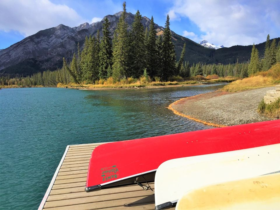 Kayaks on the jetty of the Bow River in Banff