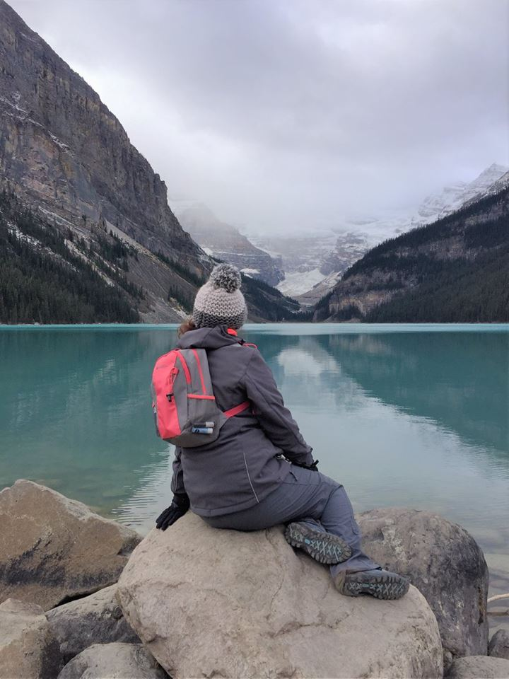 Recreating a Little Mermaid post on a rock at Lake Louise
