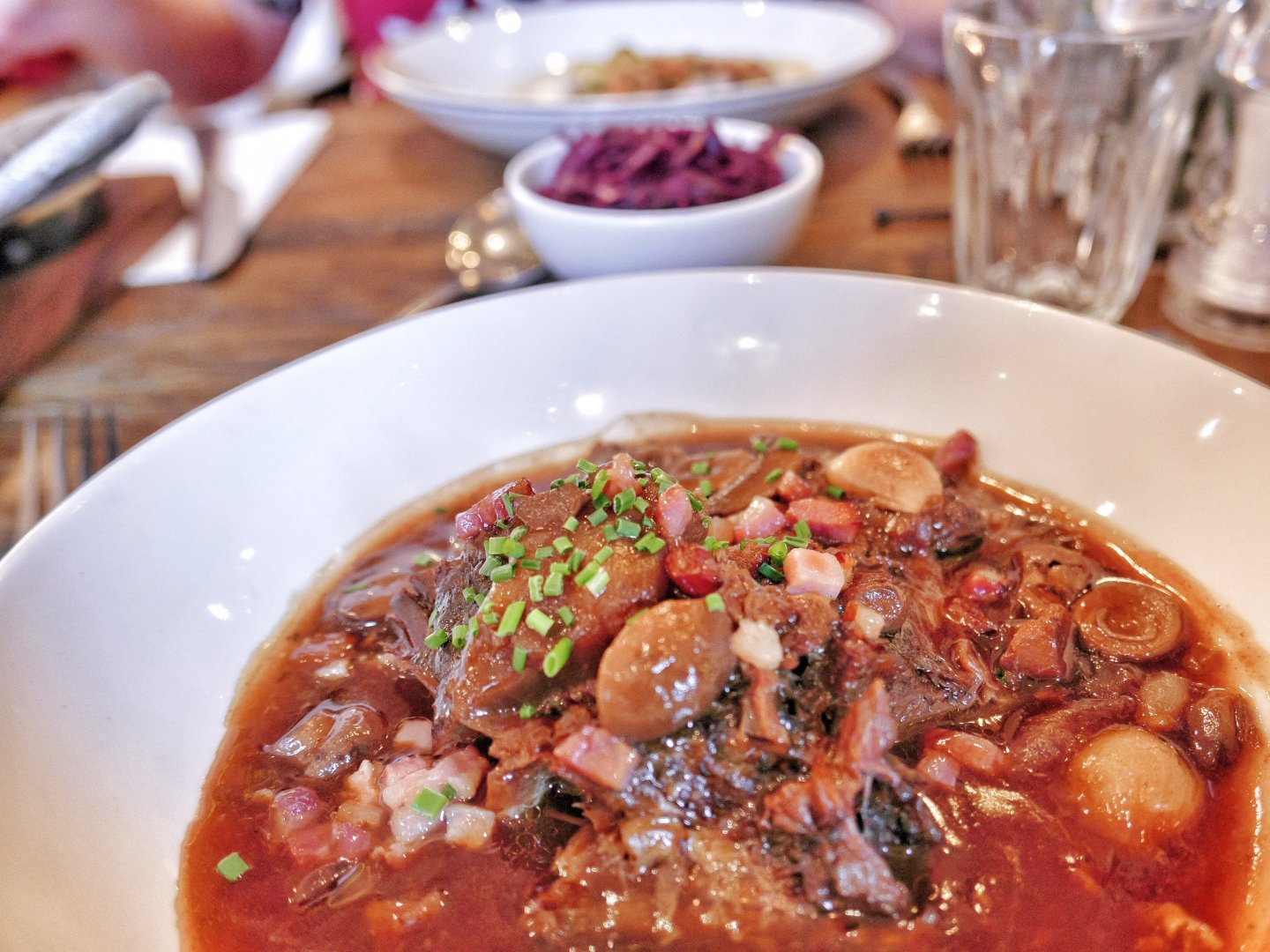 Main course at Bistrot Pierre: slow-cooked beef with shallots, red wine, bacon and mushrooms